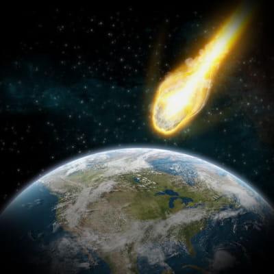 image artistique d'une chute de météorite sur terre.