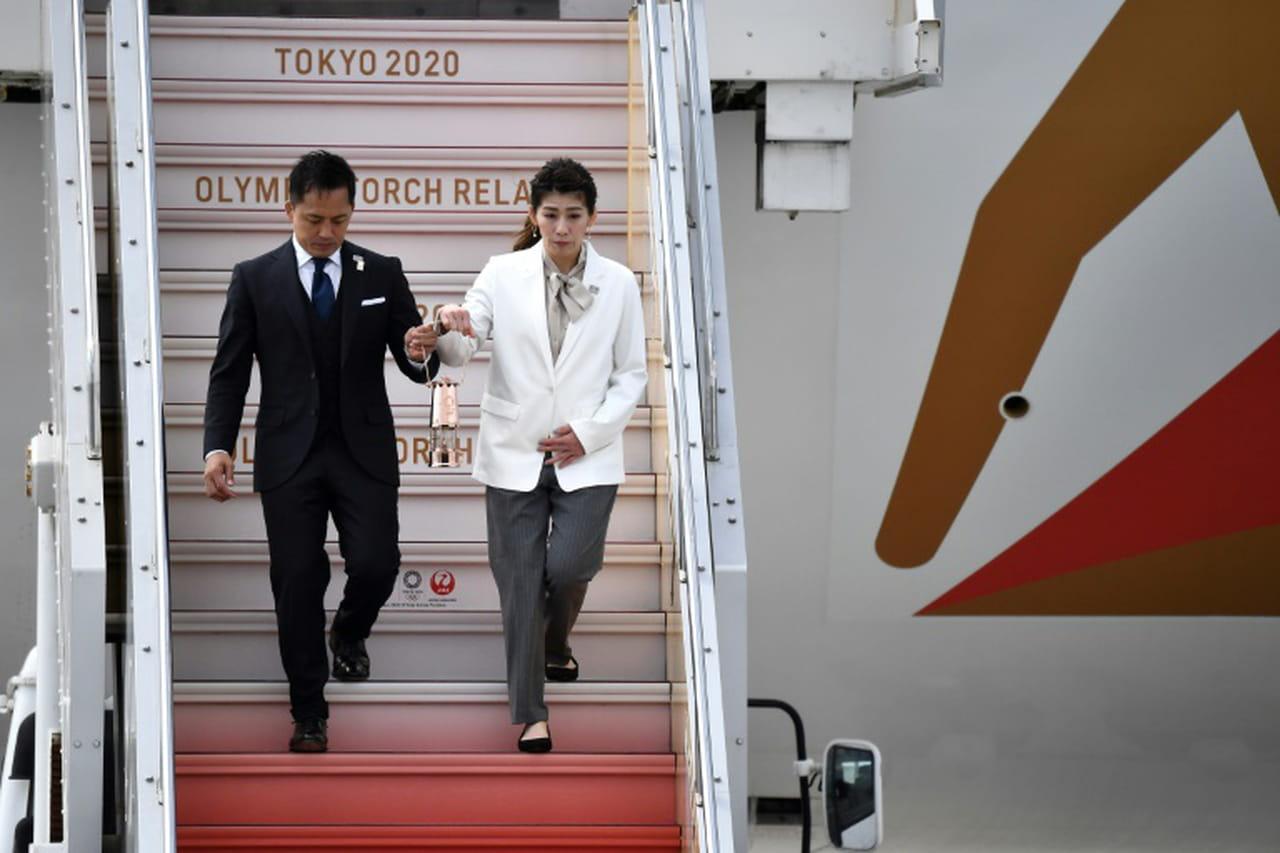 La flamme olympique de Tokyo 2020au Japon, mais les JO en suspens