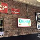 Aux Trois Couleurs  - La décoration intérieure avec les vieilles plaque émaillées et les enseignes -   © Colmar.blog
