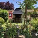 Aux Trois Couleurs  - Le jardin et son barbecue qui sert pour des soirées grillades le vendredi à la belle saison -   © Colmar.blog