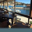 Restaurant : Achill's  - De l'intérieur, notre restaurant à Villefranche-sur-Mer vous offrira une vue toute aussi belle... -   © Lou Bantry
