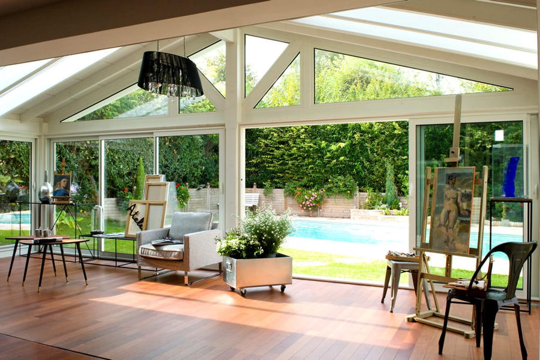 une v randa ouverte sur le jardin. Black Bedroom Furniture Sets. Home Design Ideas