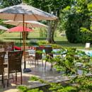 Restaurant : Le Château de Camille  - Terrasse vue sur la piscine -   © lechateaudecamille