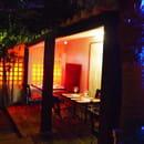 Restaurant L'Arôme - Jean-Jack Monti  - patio coin cosie rouge -