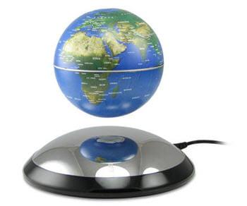 par unsimple jeu d'aimant, le globe paraît s'affranchir de toute gravité.