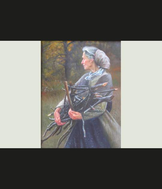 Femme ramassant du bois